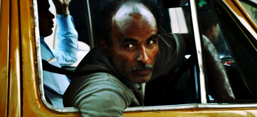 Taxi Driver in Kolkata, India. Photo by Chris JL/Flickr. Cropped.